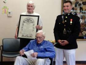 Provided by the Robert Williams family Vincent Williams (from left), 91, holds the diploma presented Saturday to his brother, Robert, 93, by a 2013 Citadel graduate, Marine 2nd Lt. Scott Holmes.